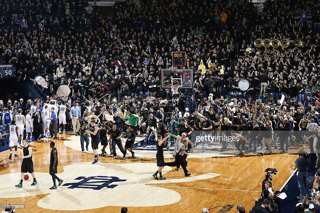 Notre Dame Fighting Irish players and fans celebrate at the end of the game against the Kentucky Wildcats at Purcell Pavilion at the Joyce Center on November 29, 2012 in South Bend, Indiana. Notre Dame won 64-50.
