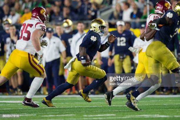 Notre Dame Fighting Irish quarterback Brandon Wimbush scrambles to the outside during the college football game between the Notre Dame Fighting Irish...