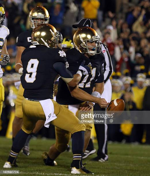 Notre Dame Fighting Irish quarterback Tommy Rees celebrates in the end zone with Notre Dame wide receiver Robby Toma after Rees scored a touchdown...