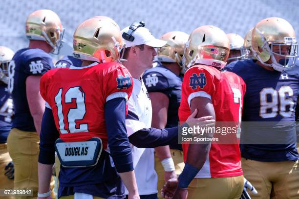 Notre Dame Fighting Irish Quarterbacks coach Tom Rees talks to Notre Dame Fighting Irish quarterback Brandon Wimbush in action during the Notre Dame...