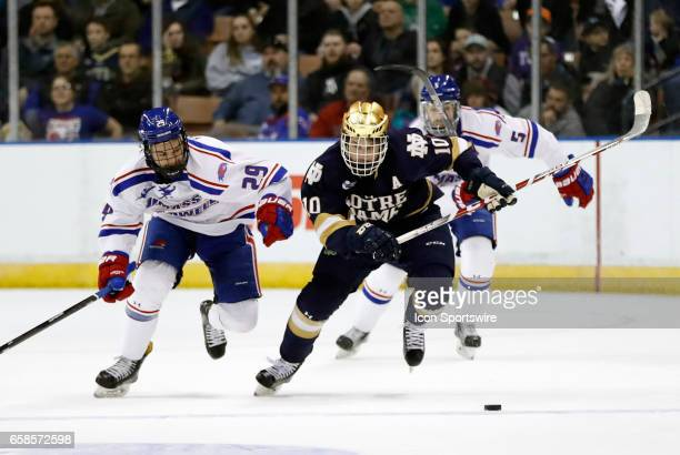 Notre Dame Fighting Irish right wing Anders Bjork breaks away from UMass Lowell River Hawks right wing John Edwardh during the NCAA Northeast...