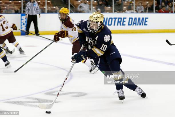 Notre Dame Fighting Irish right wing Anders Bjork carries the puck through the neutral zone during an NCAA Northeast Regional semifinal between the...