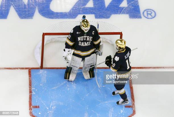 Notre Dame Fighting Irish right wing Anders Bjork checks in with Notre Dame Fighting Irish goaltender Cal Petersen before the start of the NCAA...