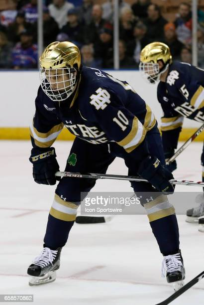 Notre Dame Fighting Irish right wing Anders Bjork eyes a defensive zone face off during the NCAA Northeast Regional final between the UMass Lowell...