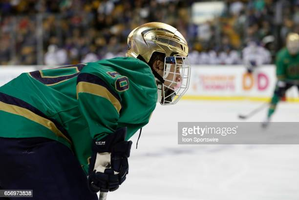 Notre Dame Fighting Irish right wing Anders Bjork eyes a face off during a Hockey East semifinal between the UMass Lowell River Hawks and the Notre...