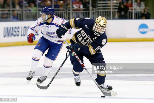 Notre Dame Fighting Irish right wing Anders Bjork gains the blue line during the NCAA Northeast Regional final between the UMass Lowell River Hawks...