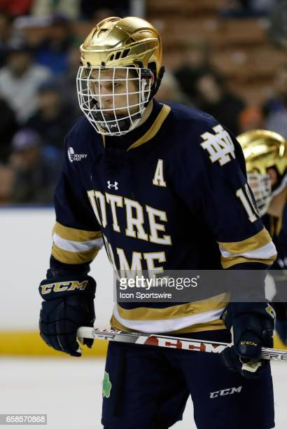 Notre Dame Fighting Irish right wing Anders Bjork gets set for a defensive zone draw during the NCAA Northeast Regional final between the UMass...