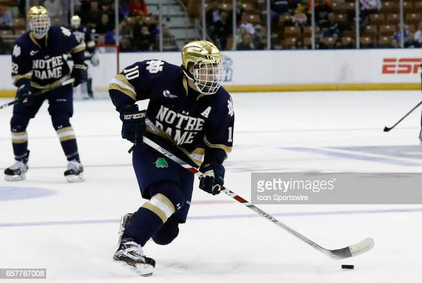 Notre Dame Fighting Irish right wing Anders Bjork looks for a shot during an NCAA Northeast Regional semifinal between the University of Minnesota...