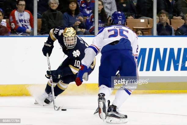 Notre Dame Fighting Irish right wing Anders Bjork makes a move on UMass Lowell River Hawks defenseman Dylan Zink during the NCAA Northeast Regional...