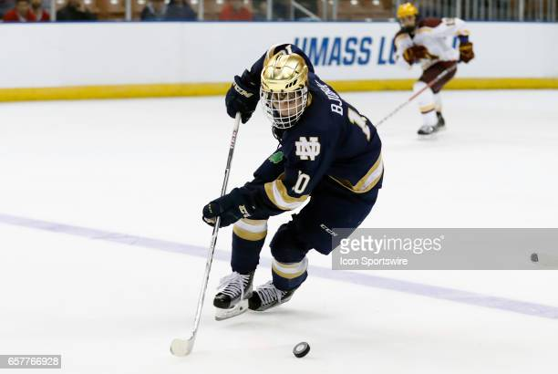 Notre Dame Fighting Irish right wing Anders Bjork picks up the puck in the neutral zone during an NCAA Northeast Regional semifinal between the...