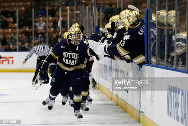 Notre Dame Fighting Irish right wing Anders Bjork skates by the bench after his second goal of the game and eventual game winner during an NCAA...