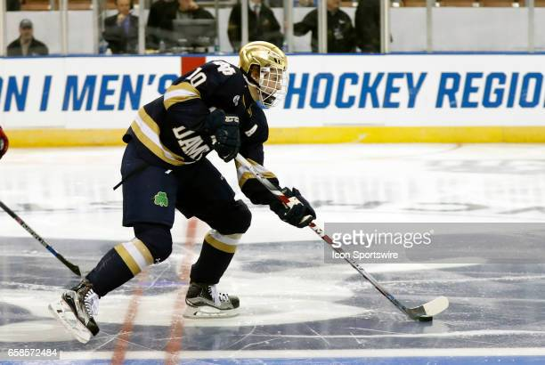 Notre Dame Fighting Irish right wing Anders Bjork skates through center ice during the NCAA Northeast Regional final between the UMass Lowell River...