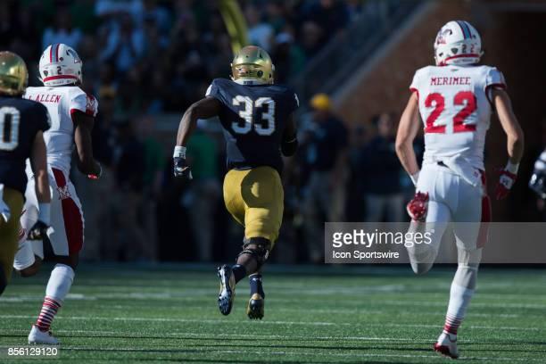 Notre Dame Fighting Irish running back Josh Adams runs for a 73yard touchdown during the college football game between the Notre Dame Fighting Irish...