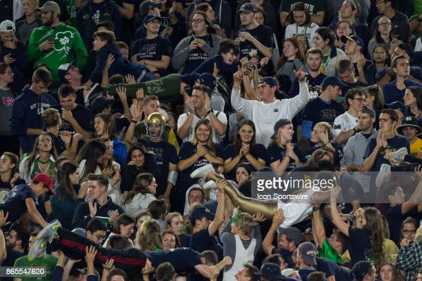 Notre Dame Fighting Irish students celebrate a touchdown during the college football game between the Notre Dame Fighting Irish and USC Trojans on...