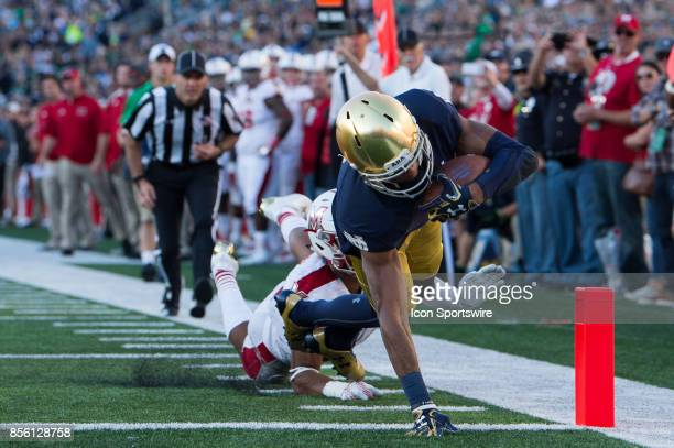 Notre Dame Fighting Irish wide receiver Equanimeous St Brown runs by Miami Redhawks defensive back Heath Harding to the endzone for a 14yard...