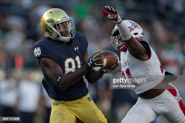 Notre Dame Fighting Irish wide receiver Miles Boykin catches a 54yard touchdown pass over the outstretched arm of Miami Redhawks defensive back...