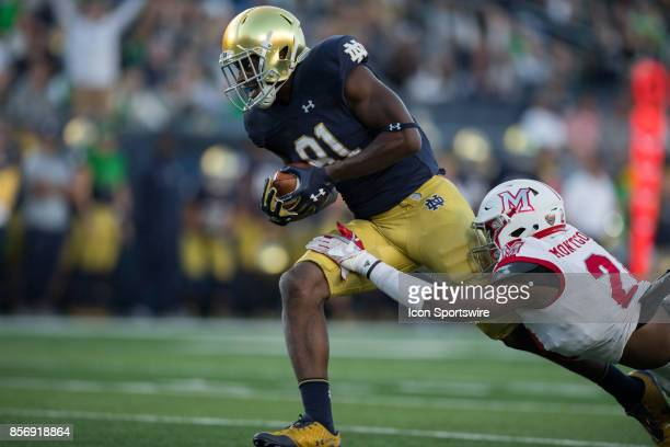 Notre Dame Fighting Irish wide receiver Miles Boykin catches a 54yard touchdown over Miami Redhawks defensive back De'Andre Montgomery during the...
