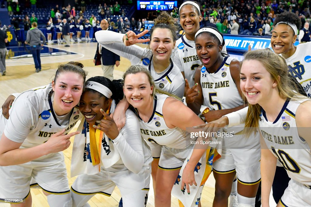 Notre Dame Fighting Irish's Arike Ogunbowale (24), Notre Dame Fighting Irish's Jessica Shepard (23), Notre Dame Fighting Irish's Jackie Young (5) and teammates celebrate after defeating the Villanova Wildcats during the second round of the Division I Women's Championship on March 18, 2018 in South Bend, Indiana.