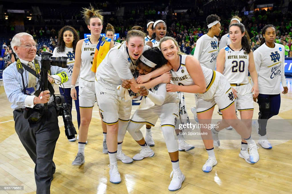 Notre Dame Fighting Irish's Arike Ogunbowale (24), Notre Dame Fighting Irish's Jessica Shepard (23), Notre Dame Fighting Irish's Marina Mabrey (3) and teammates celebrate after defeating the Villanova Wildcats during the second round of the Division I Women's Championship on March 18, 2018 in South Bend, Indiana.