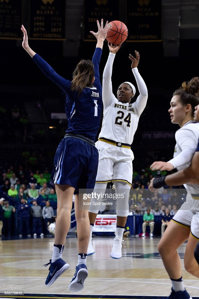 Notre Dame Fighting Irish's Arike Ogunbowale (24) shoots over Villanova Wildcats' Bridget Herlihy (1) during the second round of the Division I Women's Championship on March 18, 2018 in South Bend, Indiana.