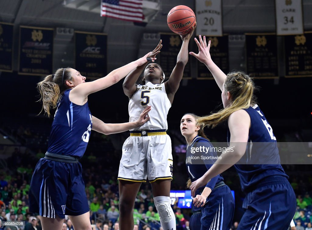 Notre Dame Fighting Irish's Jackie Young (5) shoots against Villanova Wildcats' Kelly Jekot (25) and Villanova Wildcats' Megan Quinn (12) during the second round of the Division I Women's Championship on March 18, 2018 in South Bend, Indiana.