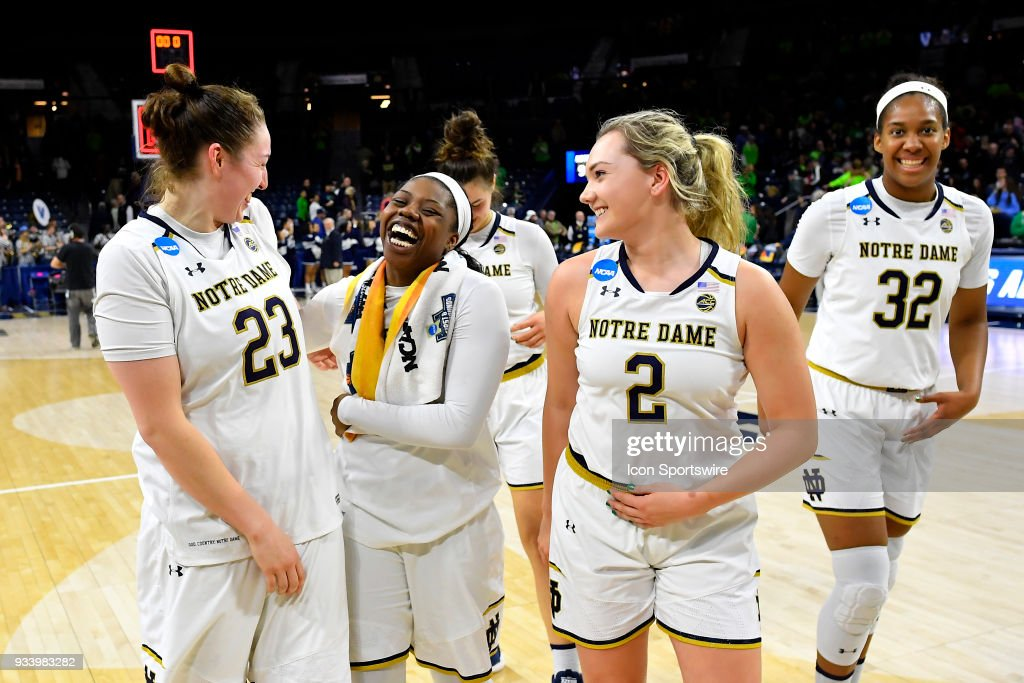 Notre Dame Fighting Irish's Jessica Shepard (23), Notre Dame Fighting Irish's Arike Ogunbowale (24), Notre Dame Fighting Irish's Kaitlin Cole (2) and teammates celebrate after defeating the Villanova Wildcats during the second round of the Division I Women's Championship on March 18, 2018 in South Bend, Indiana.