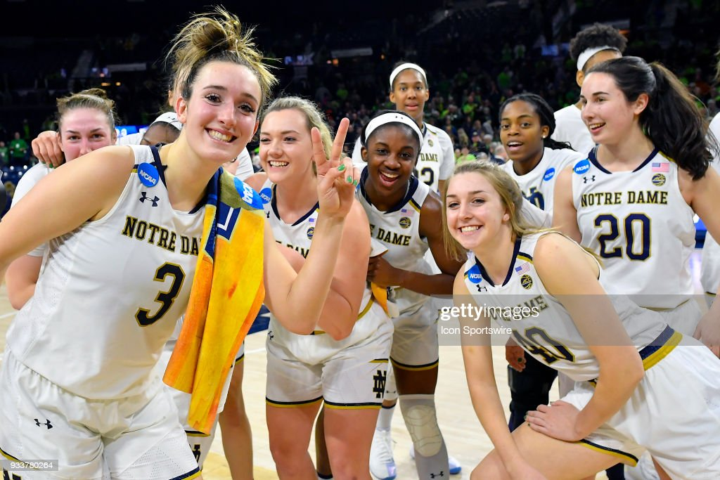 Notre Dame Fighting Irish's Marina Mabrey (3), Notre Dame Fighting Irish's Jackie Young (5) and teammates celebrate after defeating the Villanova Wildcats during the second round of the Division I Women's Championship on March 18, 2018 in South Bend, Indiana.