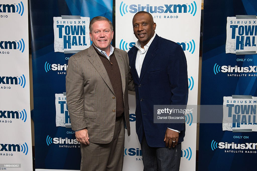 Notre Dame football coach Brian Kelly (L) and Tim Brown attend SiriusXM's Notre Dame Town Hall with Brian Kelly and Tim Brown, live from Notre Dame Stadium on April 18, 2013 in South Bend, Indiana.