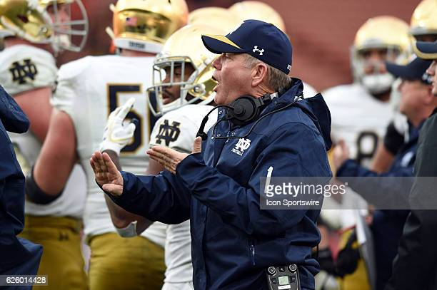 Notre Dame head coach Brian Kelly argues a turnover call due to a dropped backwards pass in the fourth quarter during an NCAA football game between...