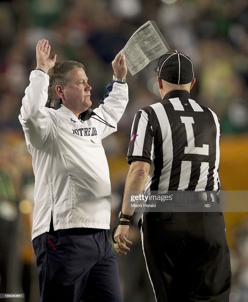 Notre Dame head coach Brian Kelly, left, is disgusted after a call on a fumbled punt in the the first quarter against Alabama in the BCS National Championship game at Sun Life Stadium on Monday, January 7, 2013, in Miami Gardens, Florida.