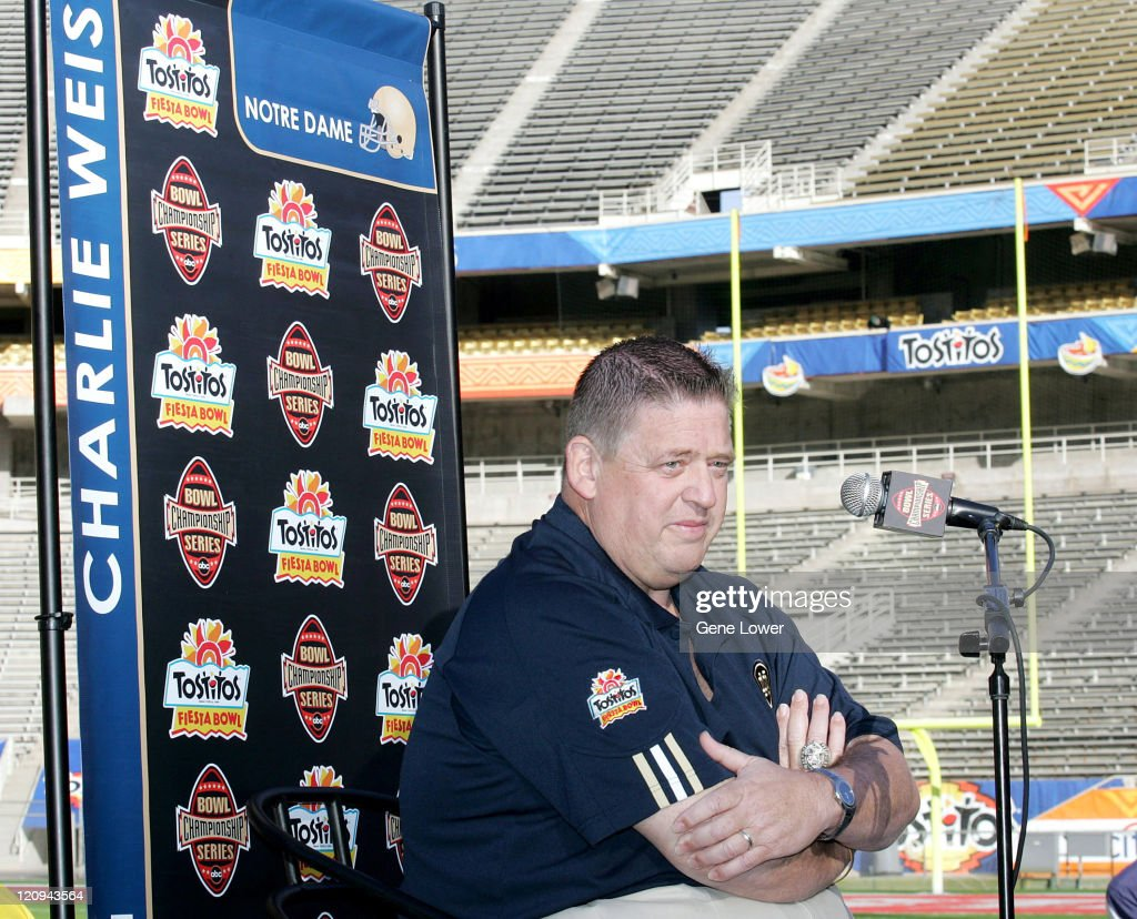 Notre Dame head coach <a gi-track='captionPersonalityLinkClicked' href=/galleries/search?phrase=Charlie+Weis&family=editorial&specificpeople=631229 ng-click='$event.stopPropagation()'>Charlie Weis</a> answers questions during Fiesta Bowl Media Day at Sun Devil Stadium in Tempe, AZ on November 30, 2005. The Irish face off against the Ohio State Buckeyes on January 2, 2005.