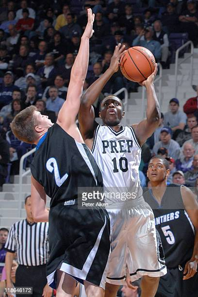 Notre Dame Prep guard Anthony Gill puts up a shot against pressure from IMG guard Nick Weiermiller during the AllAmerican Shootout at Bramlage...