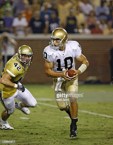 Notre Dame QB Brady Quinn scrambles away from the Georgia Tech defense during the game at Grant Field at Bobby Dodd Stadium in Atlanta GA on...