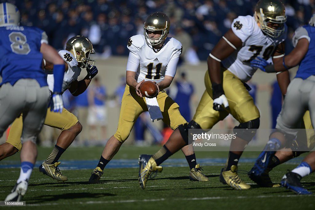 Notre Dame QB, <a gi-track='captionPersonalityLinkClicked' href=/galleries/search?phrase=Tommy+Rees+-+American+Football+Player&family=editorial&specificpeople=7175395 ng-click='$event.stopPropagation()'>Tommy Rees</a>, during the game against Air Force in the first quarter at Falcon Stadium Saturday afternoon, October 26, 2013.