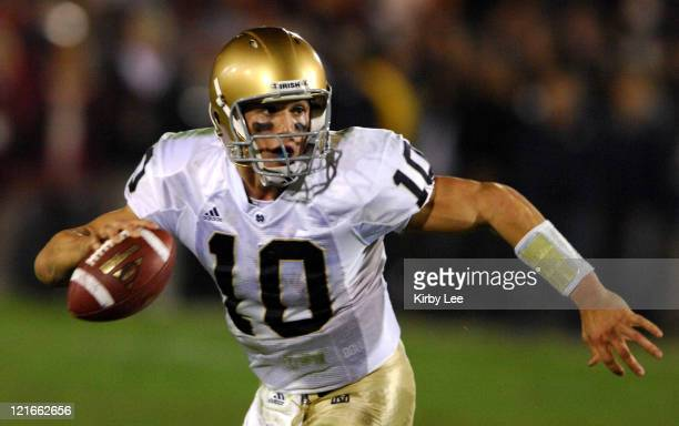 Notre Dame quarterback Brady Quinn drops back to pass during 4424 loss to USC at the Los Angeles Memorial Coliseum in Los Angeles Calif on Saturday...