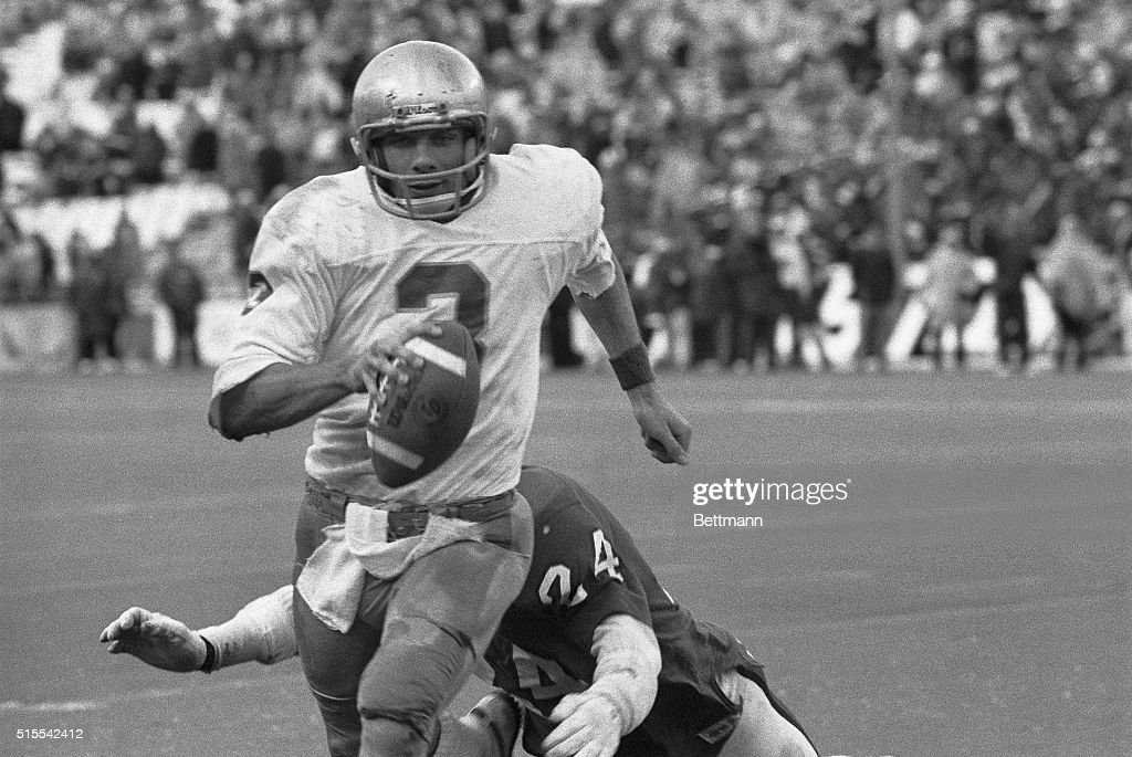 Notre Dame quarterback Joe Montana runs out of the arms of Houston's Fred Snell during the final drive of the game that led to Notre Dame's 3534...