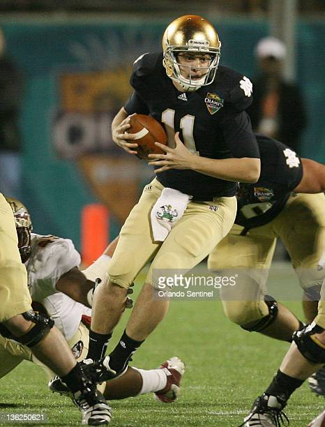 Notre Dame quarterback Tommy Rees scrambles during the Champs Sports Bowl game against Florida State at the Florida Citrus Bowl in Orlando Florida on...