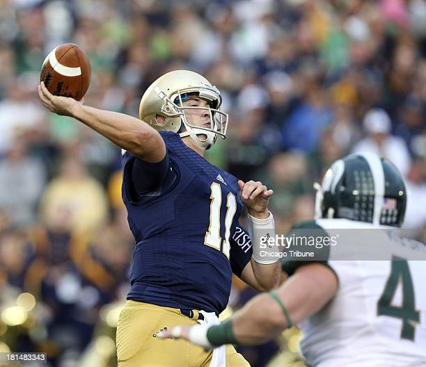 Notre Dame quarterback Tommy Rees throws a pass late in the second half against Michigan State at Notre Dame Stadium in South Bend Indiana on...