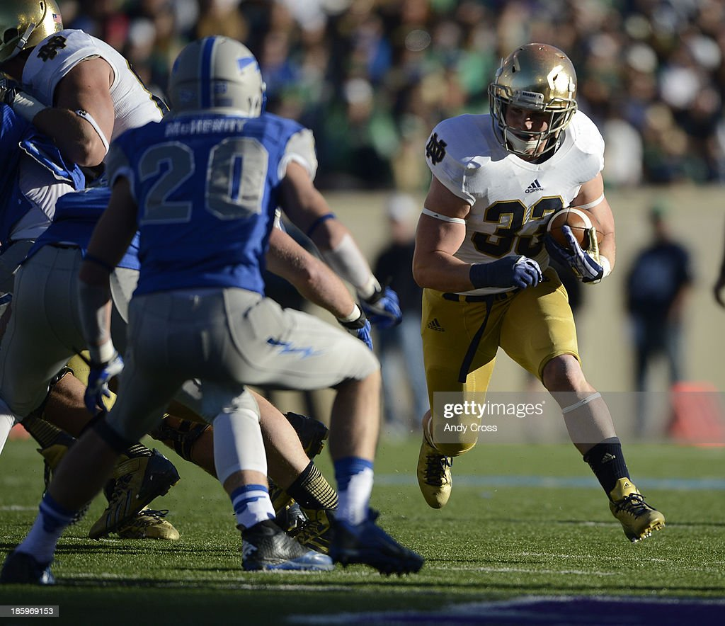 Notre Dame RB, Cam McDaniel, looks for running room against Air Force DB, Gavin McHenry, at Falcon Stadium, Saturday afternoon, October 26, 2013.