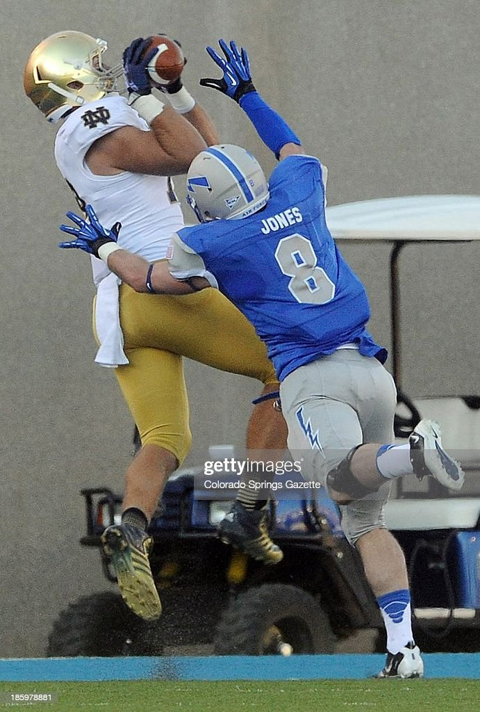 Notre Dame tight end Ben Koyack pulls in a touchdown catch as Air Force linebacker Jared Jones (8) defends in the second quarter at Falcon Stadium in Colorado Springs, Colorado, on Saturday, October 26, 2013. Notre Dame won, 45-10.