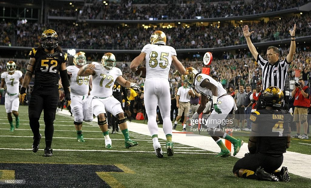 Notre Dame tight end Troy Niklas celebrates a touchdown reception against Arizona State' Alden Darby in the third quarter at AT&T Stadium in Arlington, Texas, Saturday, October 5, 2013. Notre Dame beat ASU, 37-34.
