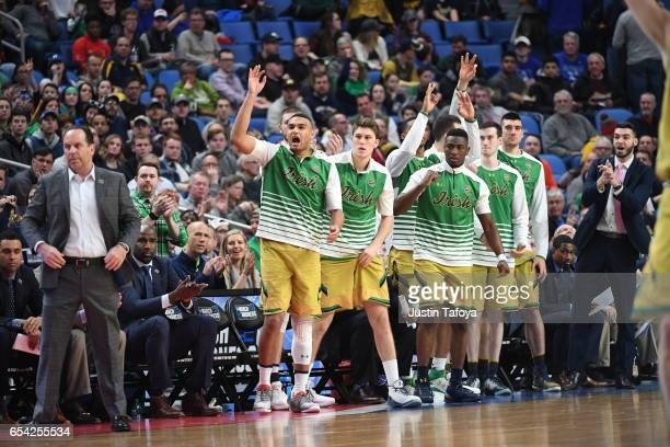 Notre Dame University bench cheers against Princeton University during the first round of the 2017 NCAA Men's Basketball Tournament held at KeyBank...