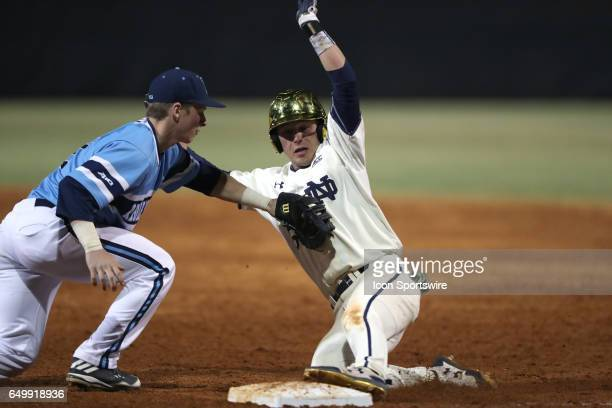 Notre Dame's Alex Kerschner is picked off of first base by Rhode Island's Brett McManus The University of Rhode Island Rams played the University of...