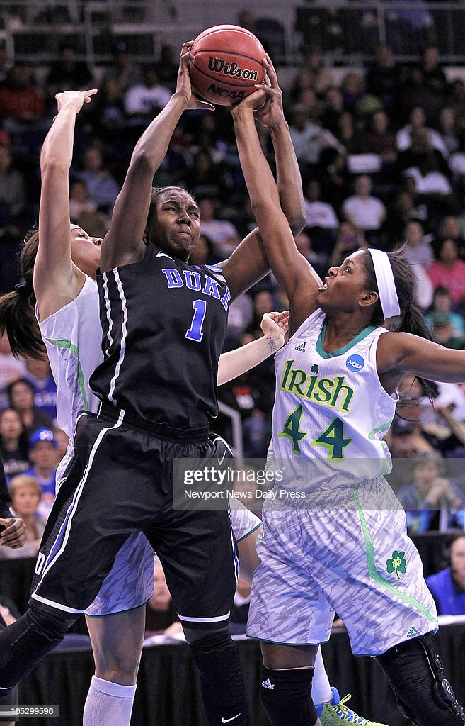 Notre Dame's Ariel Braker, right, and Natalie Achonwa battle for a rebound with Duke's Elizabeth Williams in an NCAA Tournament regional final at the Ted Constant Center in Norfolk, Virginia, on Tuesday, April 2, 2013.
