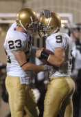 Notre Dame's Chase Anastasio and Tom Zbikowski celebrate a score during the game between the Michigan State Spartans and the Notre Dame Fighting...
