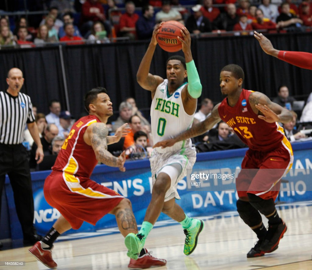 Notre Dame's Eric Atkins (0) drives to the basket between Iowa State's Chris Babb (2) and Korie Lucious (13) in the second half during the second round of the NCAA Tournament at the University of Dayton Arena, in Dayton, Ohio, on Friday, March 22, 2013. Iowa State rolled, 76-58.