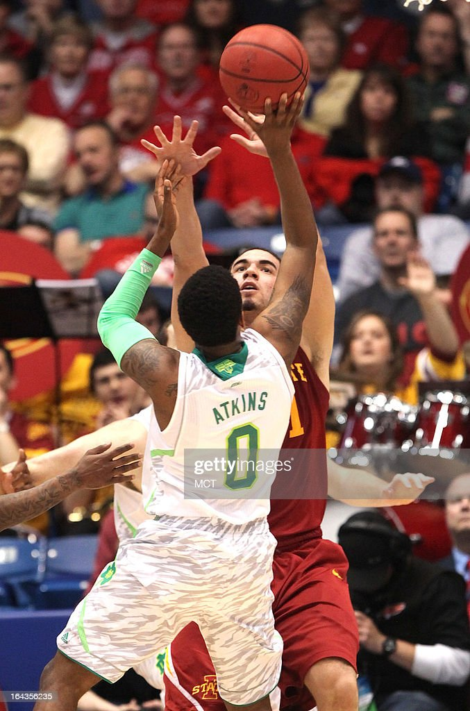 Notre Dame's Eric Atkins (0) shoots over Iowa State's Georges Niang during the first half in the second round of the NCAA Tournament at the University of Dayton Arena, in Dayton, Ohio, on Friday, March 22, 2013.