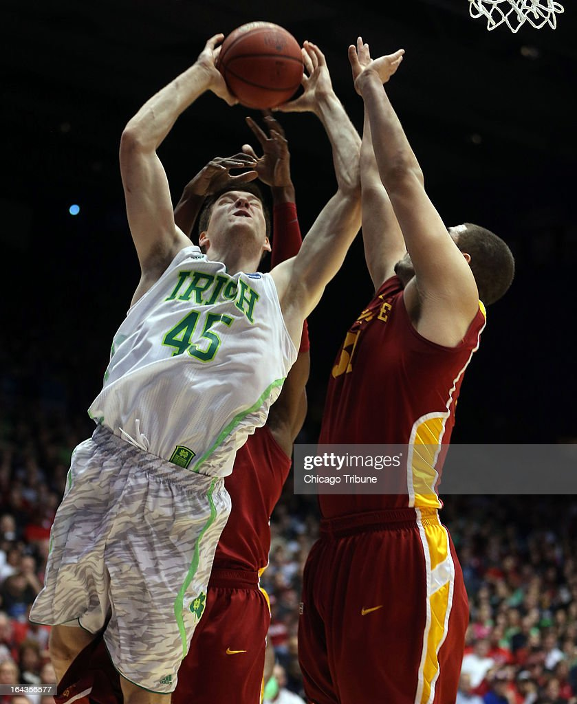 Notre Dame's Jack Cooley (45) is defended by Iowa State's Anthony Booker (22) and Georges Niang (31) in the first half during an NCAA Tournament second-round game at University of Dayton Arena in Dayton, Ohio, on Friday, March 22, 2013.