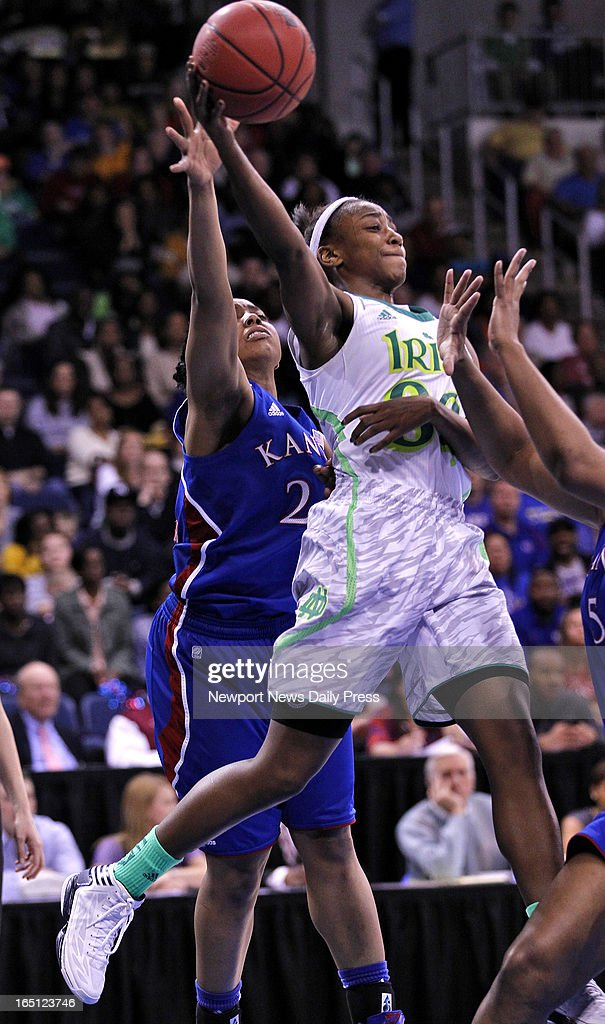 Notre Dame's Jewell Loyd, right, looks for a pass around Kansas' Cece Harper, left, during Sunday's NCAA women's basketball regional semifinal on March 31, 2013, at the Ted Constant Center in Norfolk, Virginia.