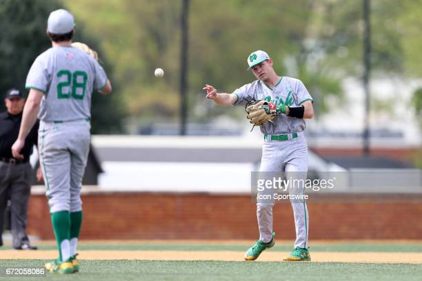Notre Dame's Kyle Fiala returns the ball to Michael Hearne after Hearne had thrown a strikeout The Wake Forest Demon Deacons hosted the University of...